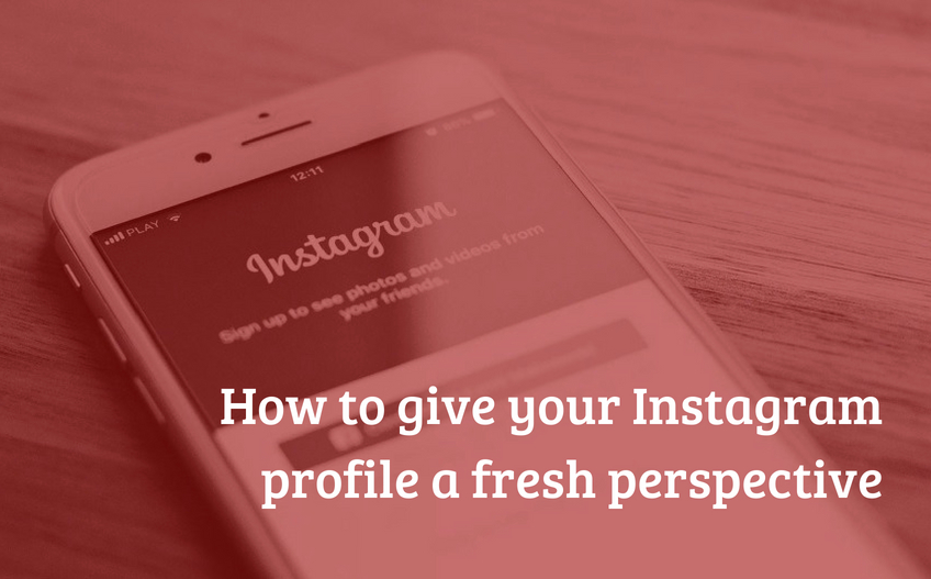 A photo of a phone displaying Instagram, with a red filter and the article title in white text